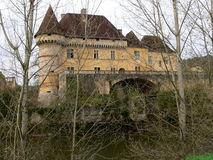 Losse castle, Thonac ( France ). Loss Castle through the trees by the river Vézère Royalty Free Stock Photos