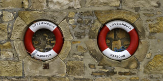 Lossiemouth lifebuoys. This is two of the Lifebuoys at Lossiemouth Harbour, Moray, Scotland Royalty Free Stock Images