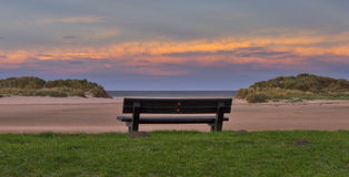 Lossiemouth sundown seat. Royalty Free Stock Images