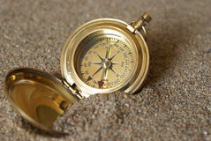 Lost. A conceptual image of a compass in the sand to amplify being lost royalty free stock photos
