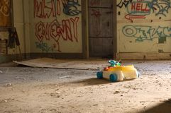 Lost. A child's toy in a lonely and abandoned place royalty free stock photos