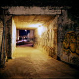 Lost. Light into the tunnel. Underground passage in the city's suburbs. Street photography. High contrast colors Royalty Free Stock Image