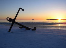 The Lost Anchor. On a snow, on a sunset royalty free stock photography