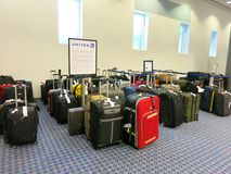 Lost Bags at United Airlines Luggage Counter. Many lost and delayed bags at the United Airlines luggage counter after a cold stretch delayed East Coast flights Royalty Free Stock Images