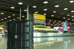 Free Lost Black Hardshell Carry-on Roller Luggage Left Unattended At The Baggage Reclaim Area At Airport Stock Photography - 146778672