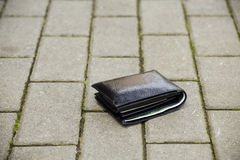 Lost black wallet Royalty Free Stock Photo