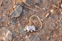 Lost bracelet in dust. Macro detail of lost bracelet in dust Stock Photos