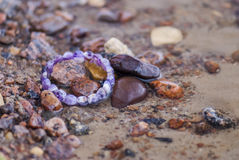 Lost bracelet in water (coastline)... Royalty Free Stock Photography