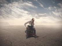 Lost Businessman. Concept of lost businessman confused sitting on suitcases Stock Photo