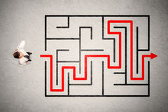 Lost businessman found the way in maze with red arrow. On grungy background Stock Photography