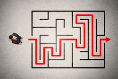 Lost businessman found the way in maze with red arrow Royalty Free Stock Image
