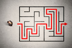 Lost businessman found the way in maze with red arrow Stock Image