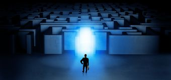 Lost businessman standing at illuminated labyrinth entrance stock photography