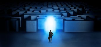 Lost businessman standing at illuminated labyrinth entrance. Lost businessman standing at the dark labyrinth with illuminated doorn Royalty Free Stock Photography