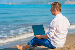 Lost businessman working on a island Royalty Free Stock Photography