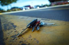 Lost Car Keys. On distressed road painted yellow lines royalty free stock images