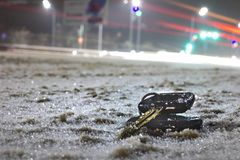 Lost car keys on the road powdered with the first snow at night. on blurred background royalty free stock image