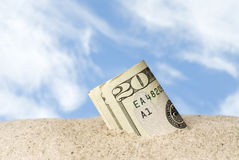 Lost cash at beach. A wad of cash lost and found in the sand at the beach Stock Photography
