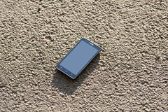 Lost cellphone on asphalt Stock Photo