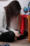 Lost of child. Young sad woman sitting in children room (lost of child concept Stock Images