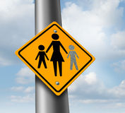 Lost Child. Or missing kid concept with a mother and children icon on a traffic sign with an empty paint spot as a symbol of parents  losing their children in a Royalty Free Stock Photo