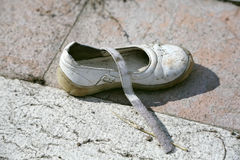 Lost children white shoe on the street Stock Images