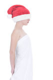 Lost christmas girl. Girl in white sheet and eyes covered with red hat Royalty Free Stock Photos