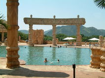 Lost city's swimming pool. Enjoyed by a few people royalty free stock image