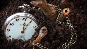 Lost Clock in the Soil Stock Image