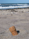 Lost cork in the beach. Old cork in the beach... somebody probably had a great party here Stock Photo