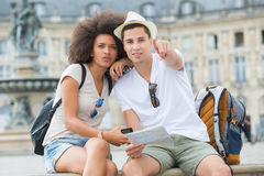 Lost couple tourists searching location stock photography