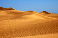 Lost in the desert?. Desert, waves, golden sand and sky