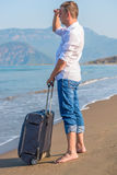 Lost on a desert island tourist looks Royalty Free Stock Photos