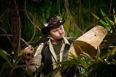 Lost explorer in the jungle Stock Image