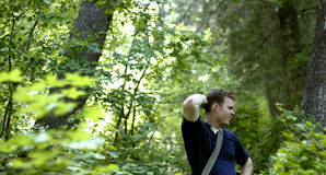Lost in the forest. Young man can't find his way Royalty Free Stock Images