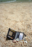 Lost and Found. A lost wallet found in the beach sand Stock Photo