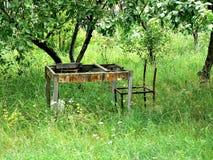 broken table in abandoned garden Stock Image
