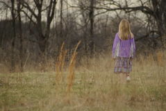 Lost girl. Alone little girl in the field Stock Photography