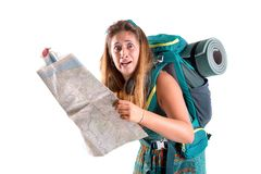 Lost girl with backpack and map royalty free stock photo