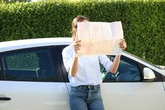 Lost Girl On Travel. Women business map problem lost beautiful young driver problem attractive Royalty Free Stock Photos