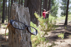 Lost glasses. Man has lost his glasses and is searching for them Stock Image