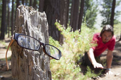 Lost glasses. Man has lost his glasses and is searching for them Royalty Free Stock Photos