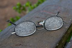 Lost glasses. On a wet bench Royalty Free Stock Images