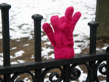 Lost glove on fence Royalty Free Stock Photo