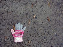 The lost glove of a small child. The concept of protecting children and the importance of their social adaptation.  royalty free stock photography