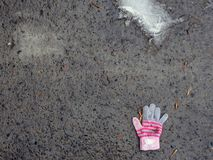 The lost glove of a small child. The concept of protecting children and the importance of their social adaptation.  stock photography
