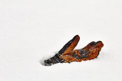 Lost glove in snow Royalty Free Stock Image
