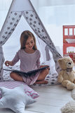 Lost in good book. Royalty Free Stock Image