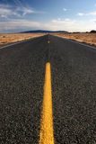 Lost highway. Long straight highway in wyoming, vertical wide angle Stock Image