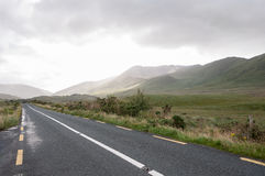 Lost highway. Irish country road on a rainy day stock image